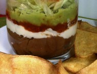 Layered Bean Dip with Baked Corn Chips