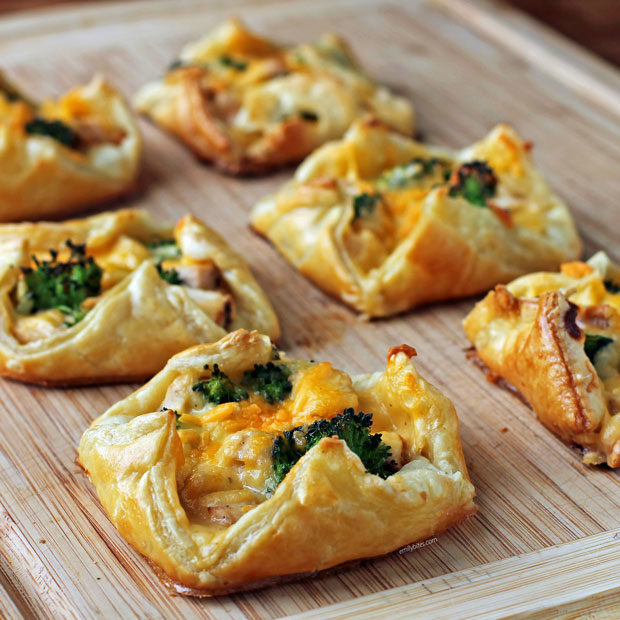 Cheesy Chicken and Broccoli Pastry Bundles on a cutting board
