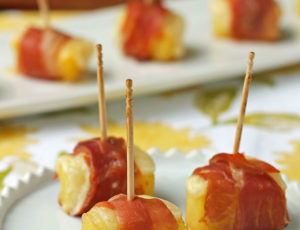Cheesy Pineapple Prosciutto Bites on a plate