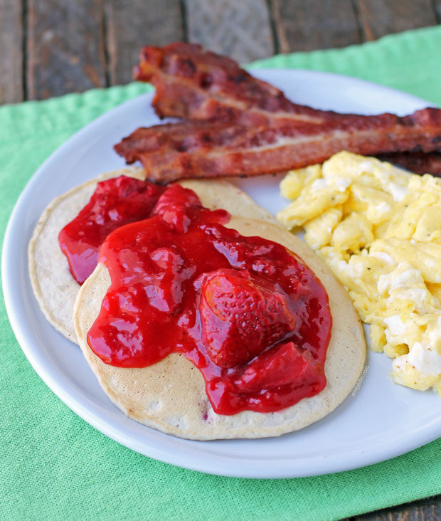 Strawberry Almond Cream Pancakes with eggs and bacon