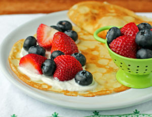 Crepes with Yogurt and Berries on a plate