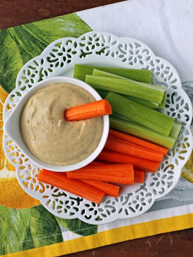Lemon Garlic Hummus with carrots and celery overhead