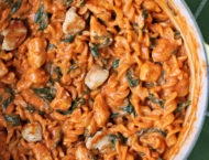 One-Pot Creamy Tomato Pasta with Chicken and Spinach in a pot