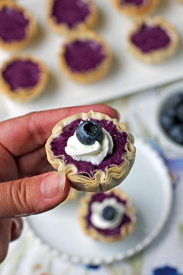 Blueberry Cheesecake Mini Tarts in hand
