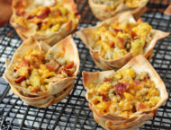 Breakfast Wonton Cups lined up on a cooling rack