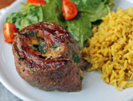 Garlic Parmesan Flank Steak Pinwheel with salad and rice