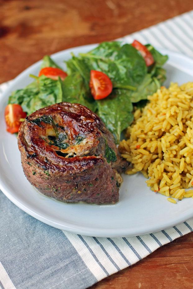 Garlic Parmesan Flank Steak Pinwheel with salad and rice