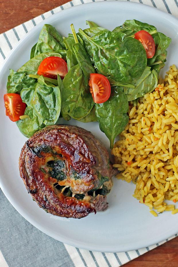 Garlic Parmesan Flank Steak Pinwheel on a plate with sides