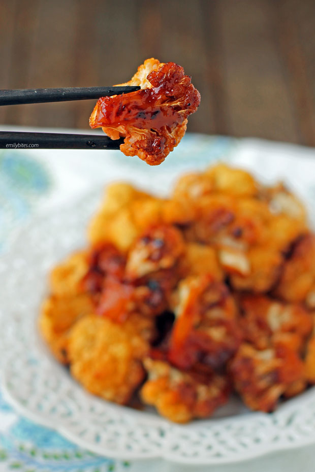 One piece of Sweet and Spicy Roasted Cauliflower in chopsticks