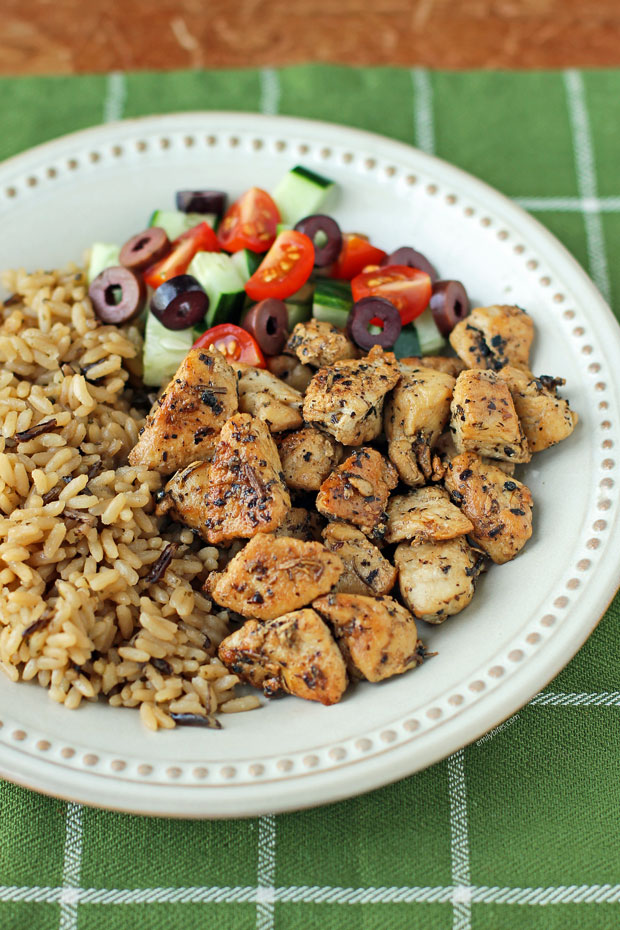 Greek Chicken Bites on a plate with rice and veggies