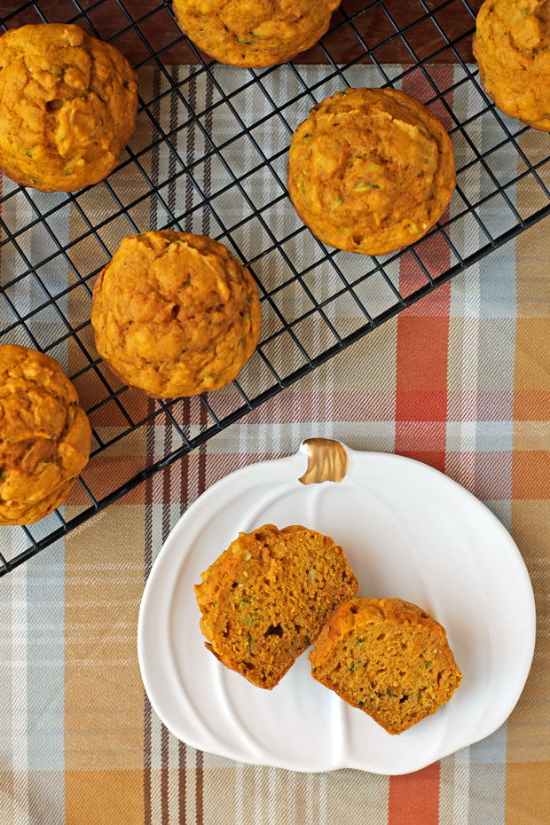Pumpkin Zucchini Muffin cut open on a plate