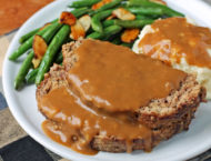 Meatloaf with Gravy on a plate with sides