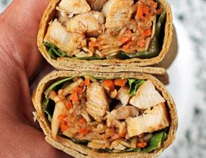 Thai Peanut Chicken Wrap in hand