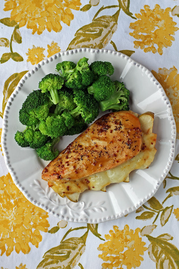 Apple and Brie Stuffed Chicken plated with broccoli
