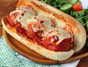 Beef and Turkey Meatball Sub plated with salad