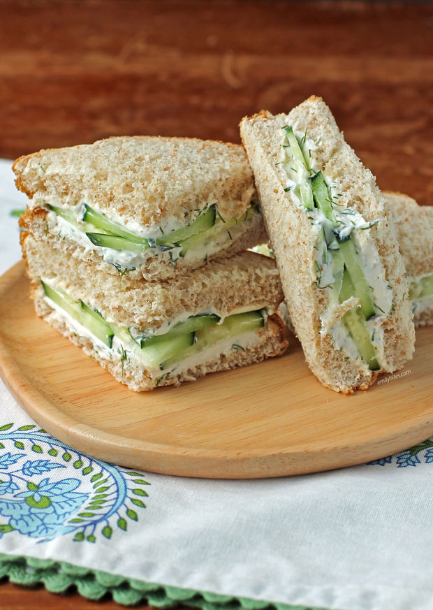 Cucumber Sandwich pieces stacked on a plate