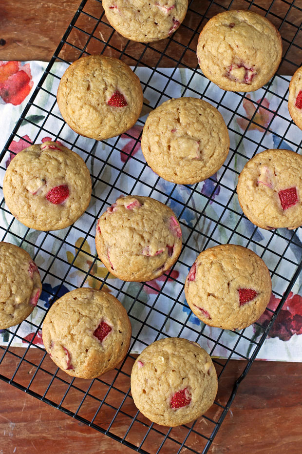 Strawberry Rhubarb Muffins on a cooling rack