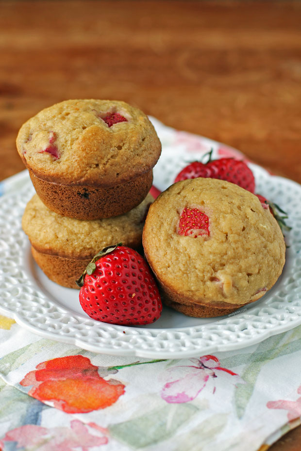 Strawberry Rhubarb Muffins stacked on a plate