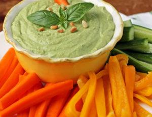 Basil Hummus in a bowl with veggies