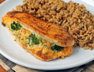 Cheese Broccoli Stuffed Chicken on a plate with rice