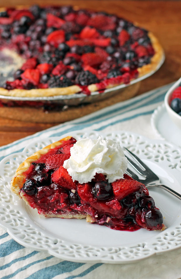 Mixed Berry Pie slice with whipped cream