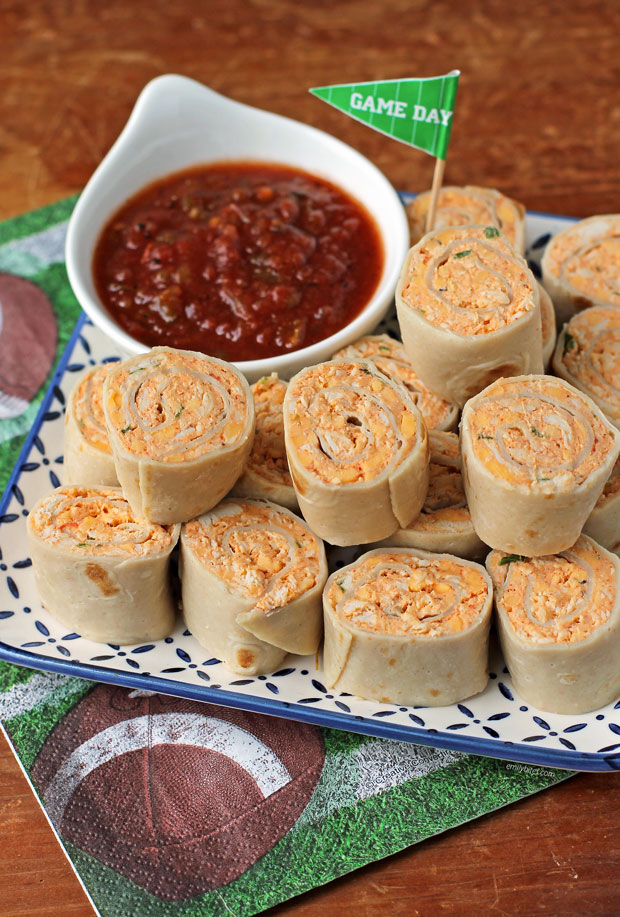 Chicken Taco Tortilla Pinwheels piled on a plate with salsa